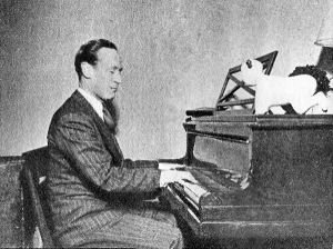 Leslie Howard playing the piano