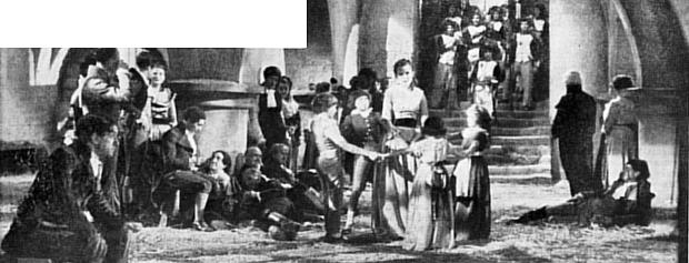 "Crowd players and principals in one of the spectacular French revolution scenes from ""The Scarlet Pimpernel"""
