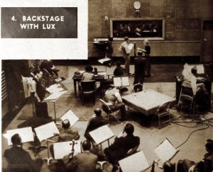 A complete production shot of the Lux Radio Theater. Deep in the background, Leslie Howard and Helen Chandler at the microphone, for the radio presentation of Berkeley Square (December 9, 1934)